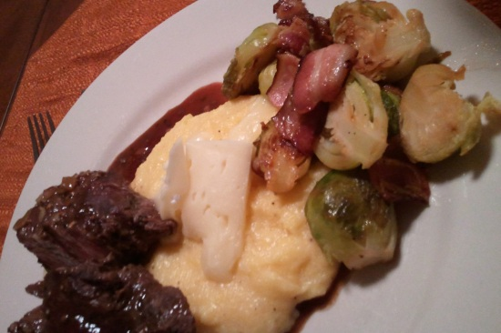 Grass fed beef tenderloin with a red wine pan reduction, Hartwell and roasted garlic polenta, sauteed brussel sprouts with onion and local Damn Fine bacon.