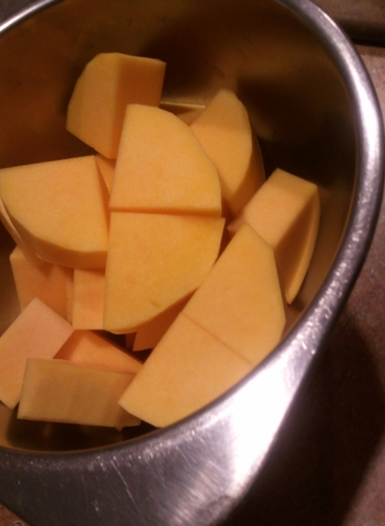 Quartered squash. Homeade Butternut And Apple Squash Soup