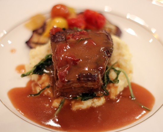 Short Ribs over soft polenta, confit tomatoes & grilled eggplant