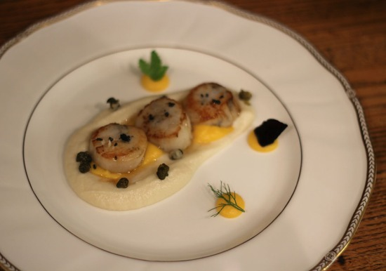 seared scallop over curried butternut squash puree, creamed cauliflower puree, brown butter, fried capers and black salt